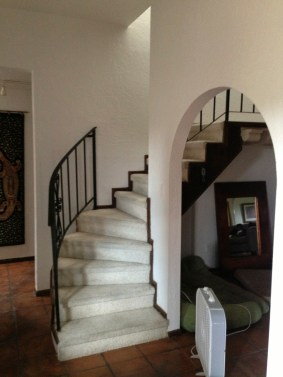 BEFORE: This tight, uncomfortable curved stair needed to go...