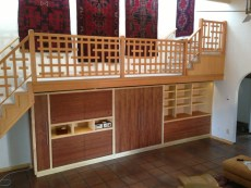 "AFTER: A new custom Doug Fir ""broken grid"" railing with Mahogany and Maple cabinetry below."