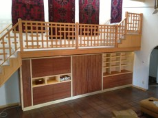 """AFTER: A new custom Doug Fir """"broken grid"""" railing with Mahogany and Maple cabinetry below."""