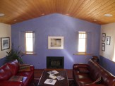 Cathedral Aspen ceiling with hand finished painted wall.