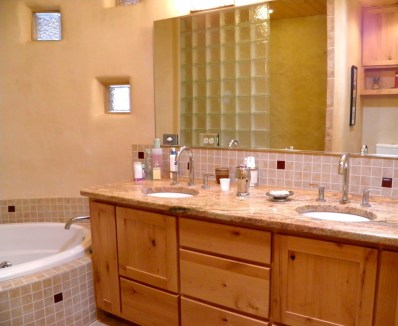 Master Bathroom. Custom Alder vanity with Grabite top. Glass block shower wall visable in mirror.