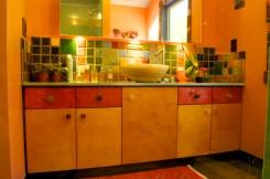 Custom vanity with Pewabic tile backsplash.