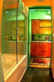 Sliding glass door on bathtub. Custom cabinetry in Laundry area.