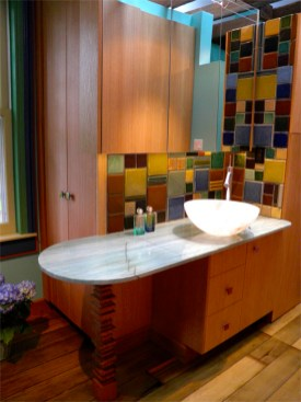 Master Bath Room with green Onyx counter and an Onyx vessel sink.