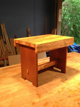 """Side table made with """"flame""""oak legs culled from the house and a Spalted Maple top."""