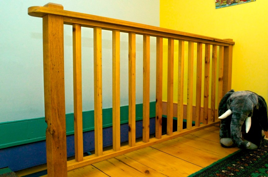 Back stair railing made from various bits of original house.