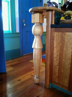 Custom turned Maple leg with Cherry cabinets in the Kitchen,