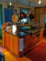 Custom Cherry island with Viking stove, Granite tops, Pewabic tile backsplash.