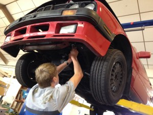 Senior Andrew Good enhances a BMW E30 in Auto Shop. Good says the class gives students all the tools to work on various automotive-themed projects.
