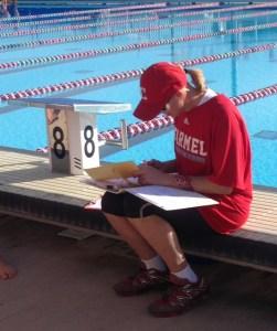 Stachelek works on the details for season's swimsuit order.