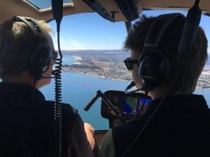 Fletcher (left) flies over Monterey coast with instructor Paul Henrichsen (right).