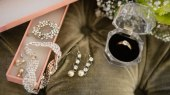 high-angle-view-of-bride-jewelry-on-sofa-5JUCL23