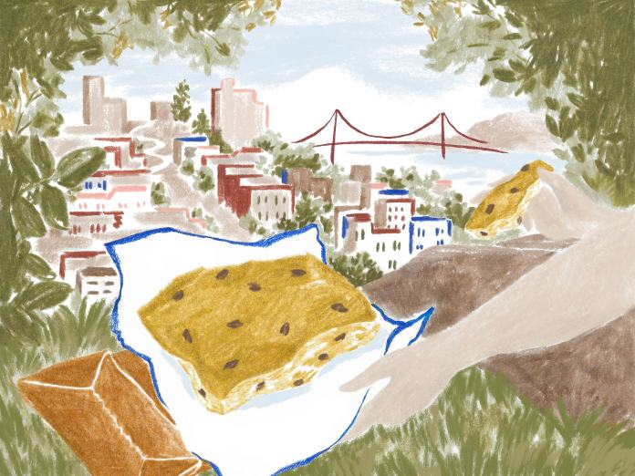 Enjoying a slice of Liguria focaccia, framed by greenery, overlooking San Francisco and the Golden Gate Bridge