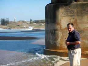 UGU Tourism CEO Justin MackRory inspects the newly closed river mouth.