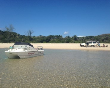 Pomene by sea: the natural sand harbour at the top of the point