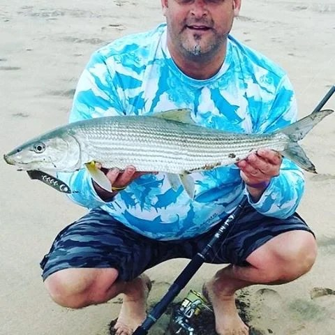 MYDO Team Member JP Bartholomew with a magnificent Bonefish taken on a MYDO SS Spoon on the KZN North Coast