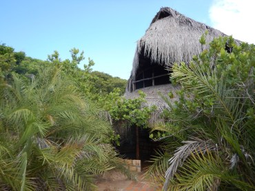 From the outside into front entrance. The beach is left, up and over the dune