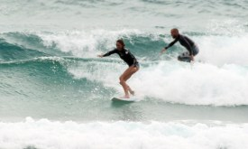 Surfing Tofo shorebreak: Team Mom and Dad Plomaritis leave a few for the kids