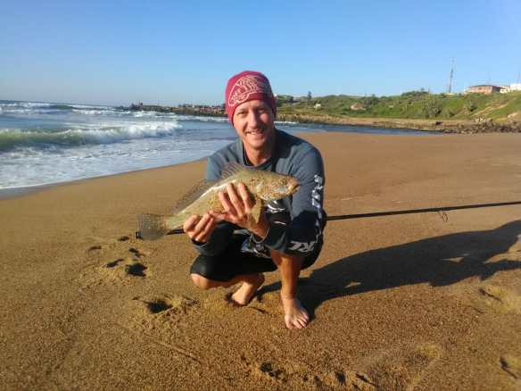Dallas with a groovy little kob at the SandSpit in Port Shepstone