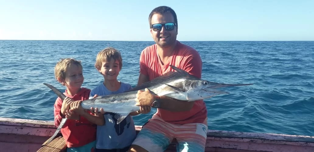 Duarte Jnr and his baby black marlin caught on spinning gear off of Nova Mambone