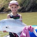 Young Mackenzie Nel and her trophy catch and release GT in the Umzimkulu