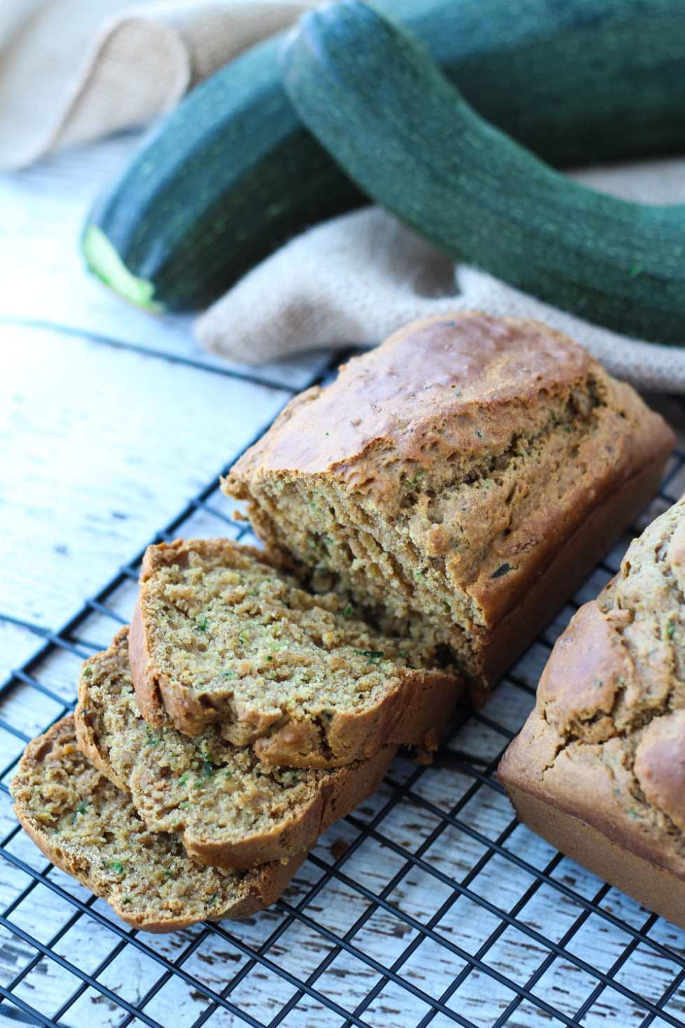sliced gluten free zucchini bread on a cooling rack