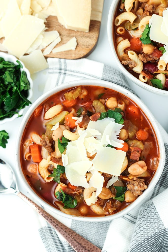 homemade minestrone soup in a bowl with cheese