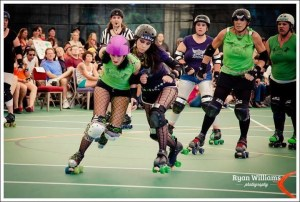 Girl checking another player in roller derby bout