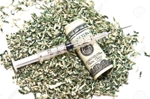 7593250-shredded-money-a-100-dollar-bill-and-a-syringe-concept-or-metaphor-for-cost-of-drugs-health-wasting-stock-photo