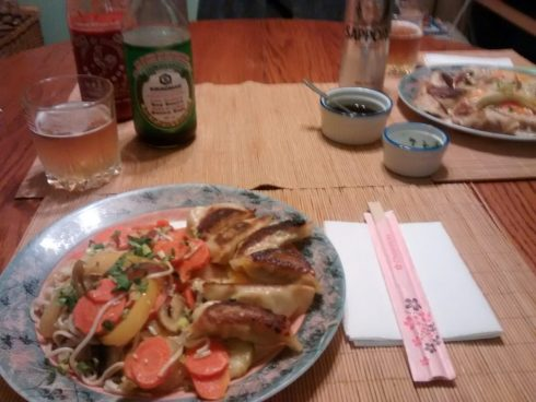 dumplings with veggies on the table