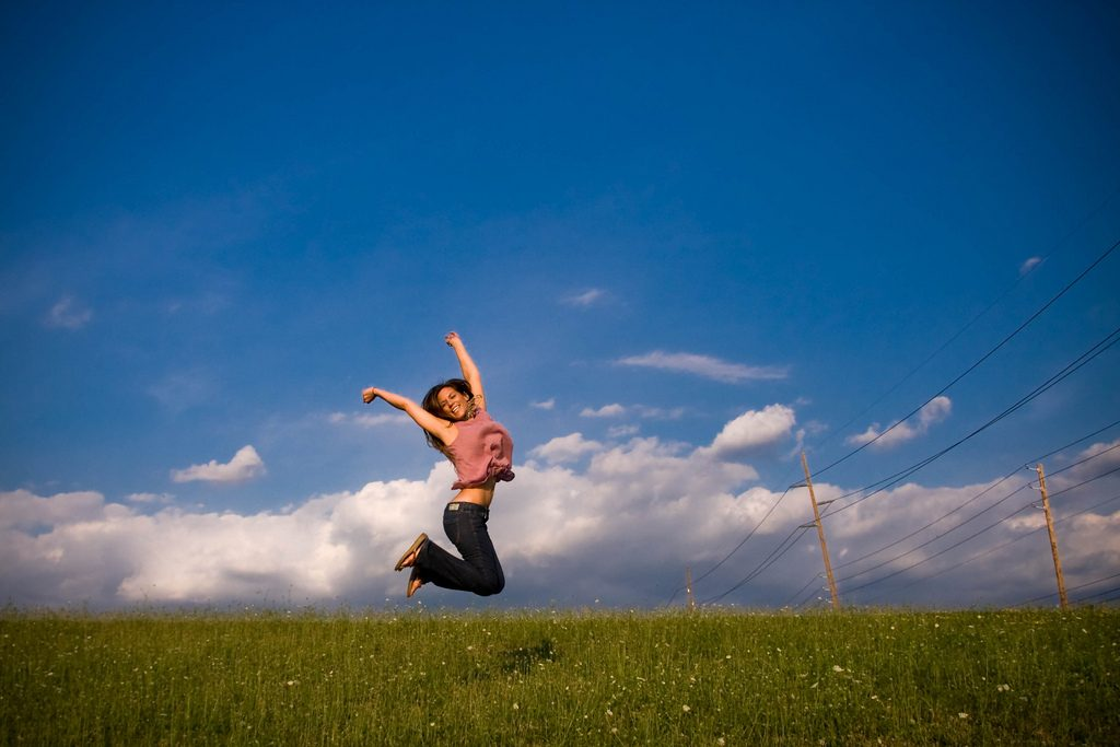Girl jumping with passion