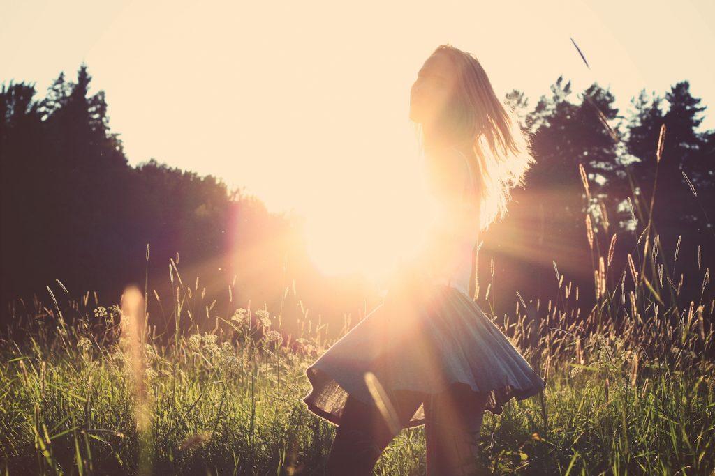 Girl walking in sunshine