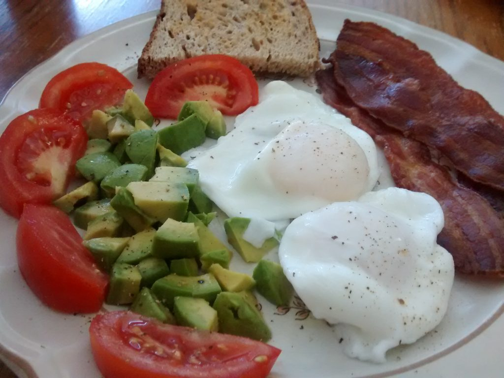Poached eggs bacon avocado tomato toast