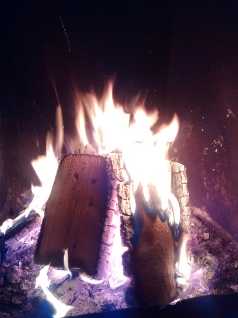 Fire logs aflame