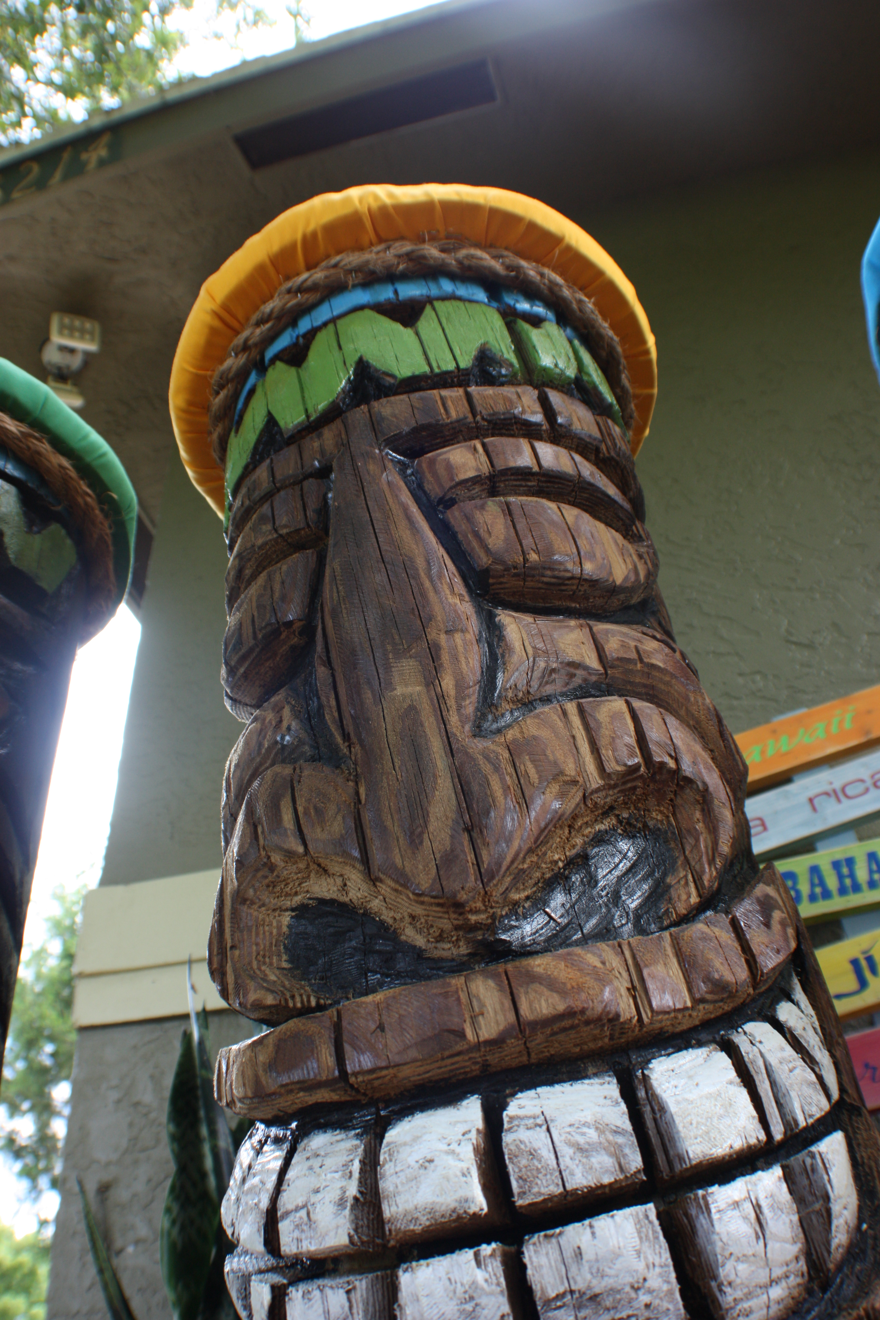 THE SAW DOG  tiki huts and chainsaw carvings