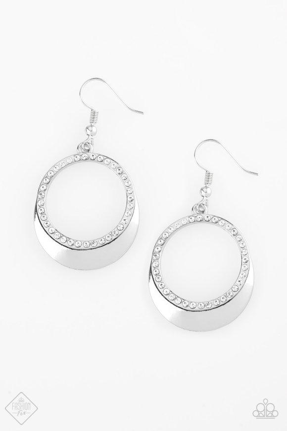 circular silver earrings white rhinestones lining the bottom