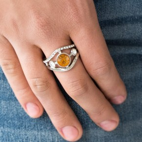ring with orange stone and rhinestone