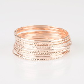 gold bangles with varying textures