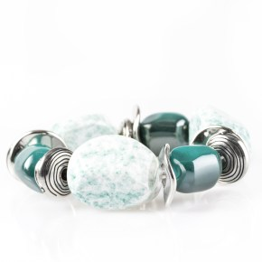 """Chunky blue beads combine with intricate silver details on a stretchy band. Sold as one individual bracelet. Get The Complete Look! Necklace: """"In Good Glazes - Blue"""" (Sold Separately)"""