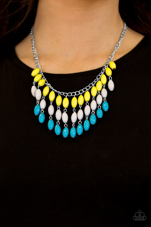 Faceted yellow, gray, and blue beads cascade from the bottom of a shimmery silver chain, creating a flirty fringe below the collar. Features an adjustable clasp closure. Sold as one individual necklace. Includes one pair of matching yellow earrings.