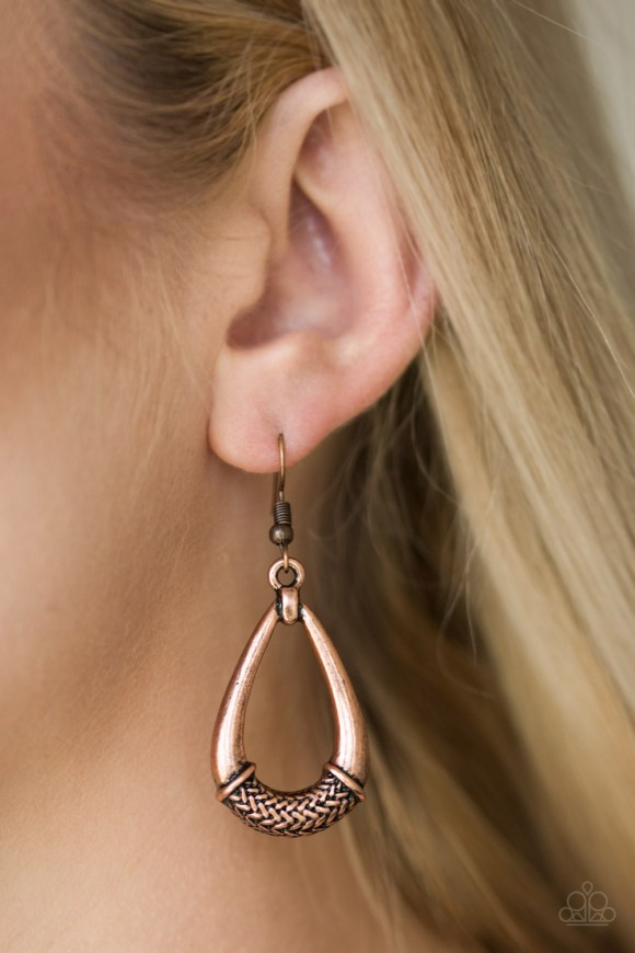 The center of a glistening copper teardrop is embossed in a metallic rope-like pattern for an artisan inspired look. Earring attaches to a standard fishhook fitting. Sold as one pair of earrings.
