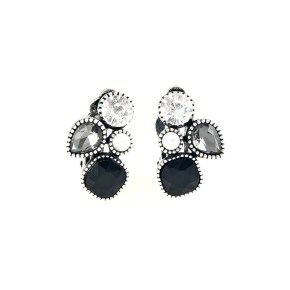 Infused with a dainty white pearl, mismatched black, smoky, and white rhinestones coalesce into a glittery frame. Earring attaches to a standard clip-on fitting. Sold as one pair of clip-on earrings.