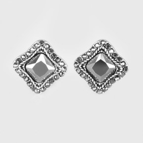 Encrusted in dazzling hematite rhinestones, an asymmetrical square frame encases a glittery hematite gem for a regal look. Earring attaches to a standard clip-on fitting.