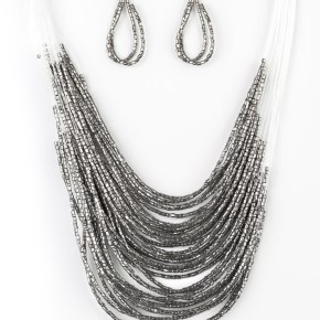 Strand after strand of shimmering gunmetal seed beads fall together to create a bold statement piece. Features an adjustable clasp closure. Sold as one individual necklace. Includes one pair of matching earrings.