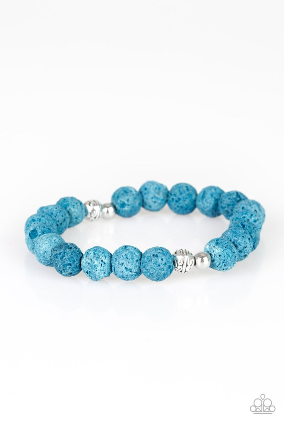 A collection of ornate silver accents and blue lava rocks are threaded along a stretchy band around the wrist for a seasonal look. Sold as one individual bracelet.