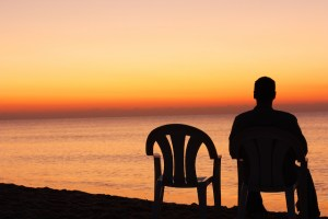 Man-Sitting-Alone