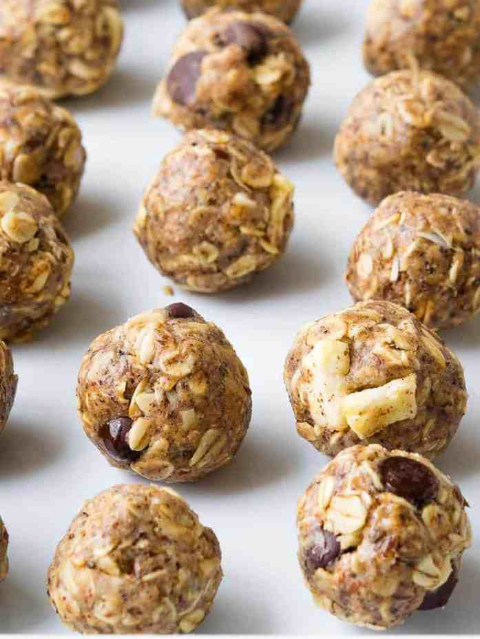 healthy to go oatmeal energy balls on a sheet pan in 4 different flavors
