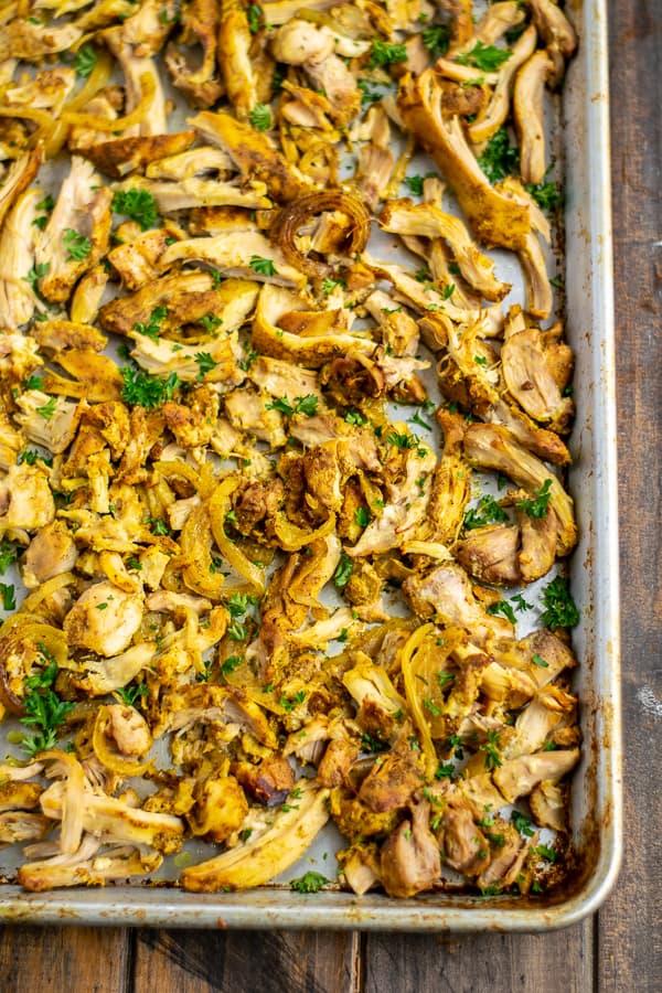 shredded chicken shawarma on a sheet pan