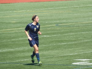 Junior Maria Zandi following the play up the field.