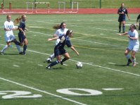 Junior Jamie Midgley and senior Carina Wilden moving the ball up the field in an attempt to score late in the game.